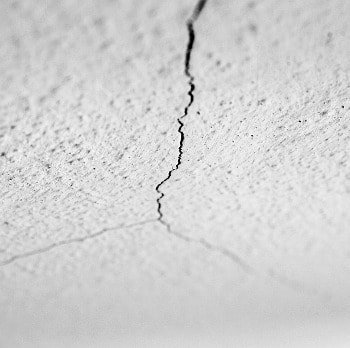 photo of three diagonal cracks in textured drywall ceiling cracks