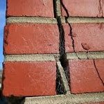 crack in brick foundation from foundation shifting and movement