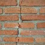 vertical crack in brick masonry wall