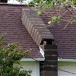 leaning, tilting chimney on Alabama home