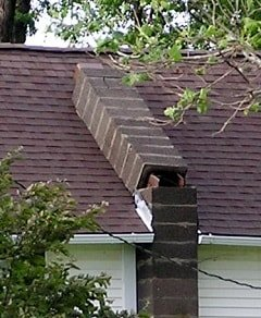 Photo of house with chimney completely leaning onto the roof