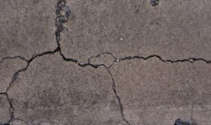 several cracks in concrete driveway slab