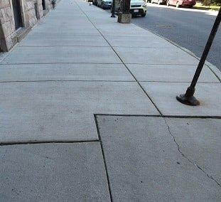 sinking concrete slab in sidewalk